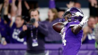 MINNEAPOLIS, MN - JANUARY 14: Wide receiver Stefon Diggs #14 of the Minnesota Vikings celebrates as he runs into the endzone for the game-winning touchdown as the Vikings defeat the New Orleans Saints 29-24 to win the NFC divisional round playoff game at U.S. Bank Stadium on January 14, 2018 in Minneapolis, Minnesota.   Jamie Squire/Getty Images/AFP