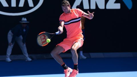 MELBOURNE, AUSTRALIA - JANUARY 19: Grigor Dimitrov of Bulgaria in action against Andrey Rublev (not seen) of Russia during the fifth day of 2018 Australia Open at Melbourne Park in Melbourne, Australia on January 19, 2018. Recep Sakar / Anadolu Agency