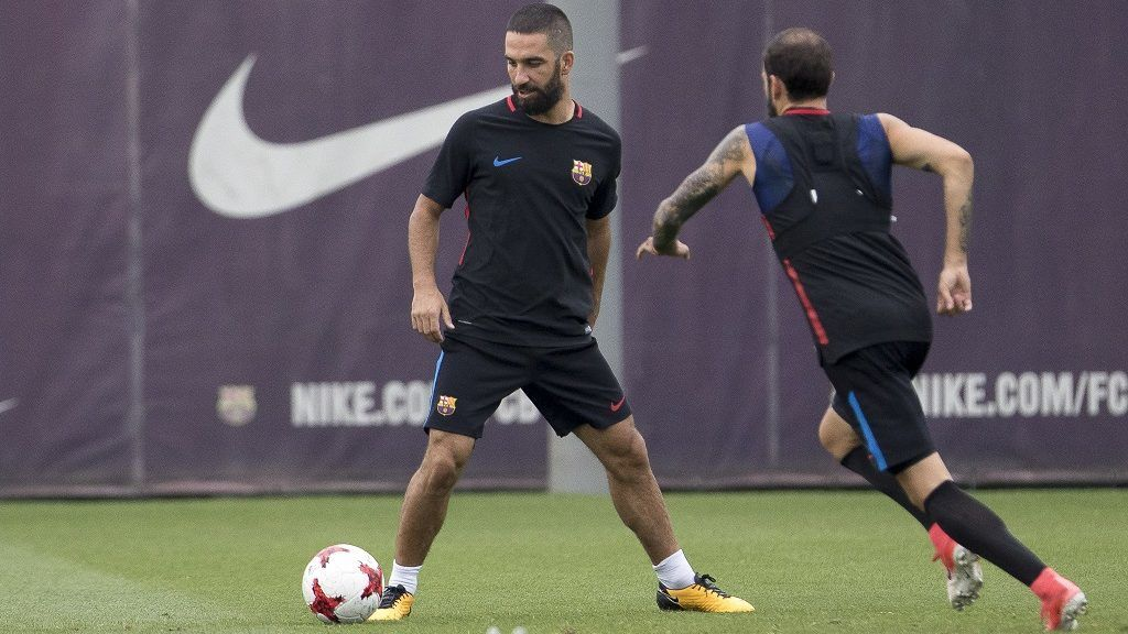 BARCELONA, SPAIN - AUGUST 15: Arda Turan (L) and Aleix Vidal (R) of Barcelona attend a training session prior the Spanish Supercup second leg football match Real Madrid vs FC Barcelona in Sant Joan Despi, Spain on August 15, 2017. Albert Llop / Anadolu Agency