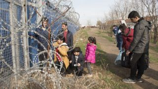 SUBOTICA, SERBIA – MARCH 23 : A Syrian family waits next to the border gate, after they were selected to claim asylum in Hungary at  the Kelebija border crossing , Subotica, Serbia on March 23,2017. Omar Marques / Anadolu Agency