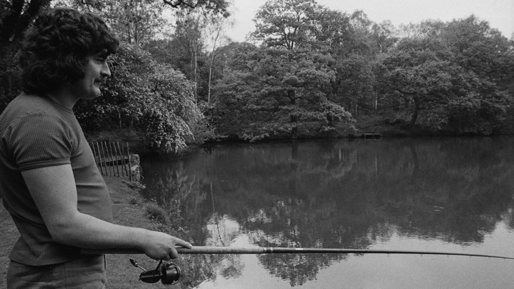 English singer, songwriter and flautist, Ray Thomas, of The Moody Blues, fishing in a lake, 31st May 1973. (Photo by Michael Putland/Getty Images)