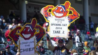 CLEVELAND, OH -  APRIL 5:  Cleveland Indians fans hold up Chief Wahoo signs prior to the game against the Boston Red Sox the opening day game at Progressive Field on April 5, 2016 in Cleveland, Ohio. (Photo by Jason Miller/Getty Images)