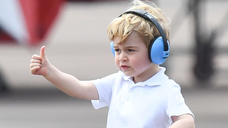 FAIRFORD, ENGLAND - JULY 08:  Prince George of Cambridge gives a thumbs up as he attends the The Royal International Air Tattoo at RAF Fairford on July 8, 2016 in Fairford, England.  (Photo by Samir Hussein/WireImage)