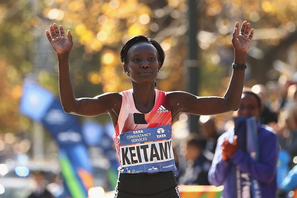 NEW YORK, NY - NOVEMBER 06:  Mary Keitany of Kenya crosses the finish line to finish first in the Professional Women's Division during the 2016 TCS New York City Marathon in Central Park on November 6, 2016 in New York City.  (Photo by Elsa/Getty Images)