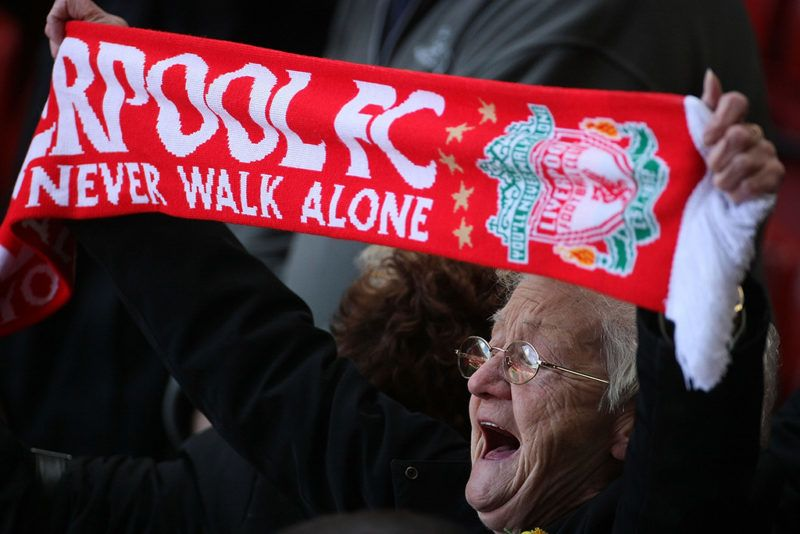 LIVERPOOL, UNITED KINGDOM - APRIL 15:  A Liverpool fan sings 'You'll Never Walk Alone' during a service at Anfield football stadium in Liverpool to mark the 19th anniversary of the Hillsborough disaster on 15 April, 2008, Liverpool, England.  A total of 96 Liverpool supporters lost their lives during a crush at an FA Cup semi final against Nottingham Forest at the Hillsborough football ground in Sheffield, South Yorkshire in 1989.  (Photo by Christopher Furlong/Getty Images)
