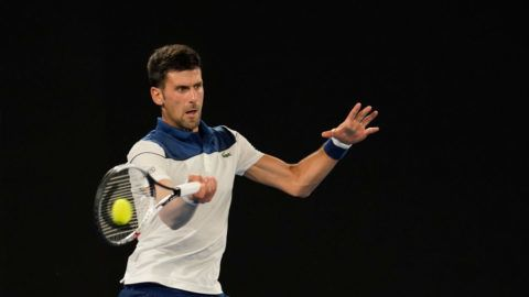 MELBOURNE, AUSTRALIA - JANUARY 22:  Novak Djokovic of Serbia plays a forehand in his fourth round match against Hyeon Chung of South Korea on day eight of the 2018 Australian Open at Melbourne Park on January 22, 2018 in Melbourne, Australia.  (Photo by XIN LI/Getty Images)