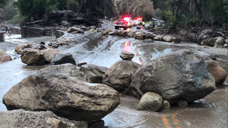 """Rocks block the Hot Springs Road in Montecito following debris and mud flow due to heavy rain falls in Montecito, California, on January 9, 2018.   Waist-deep mudflow in the Montecito knocked houses from their foundations, Santa Barbara County Fire Department spokesman Mike Eliason told the LA Times. / AFP PHOTO / Santa Barbara Fire Dpt / Mike ELIASON / RESTRICTED TO EDITORIAL USE - MANDATORY CREDIT """"AFP PHOTO / Santa Barbara Fire Depatment/ Mike ELIASON"""" - NO MARKETING NO ADVERTISING CAMPAIGNS - DISTRIBUTED AS A SERVICE TO CLIENTS"""