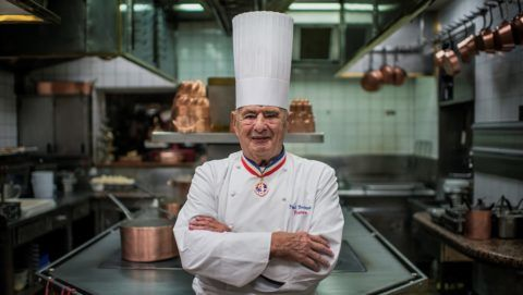 (FILES) This file photo taken on November 09, 2012 shows French chef Paul Bocuse posing in his kitchen at L'Auberge de Pont de Collonges, during a culinary work shop in Collonges-au-Mont-d'Or. Bocuse died at the age of 91 on January 20, 2018, according to French Interior Minister Gerard Collomb. / AFP PHOTO / JEFF PACHOUD