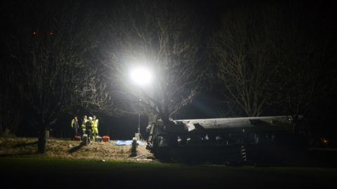 Members of the emergency services work at the scene where a bus crashed near Horomerice, in the northwestern suburbs of the Czech Republic's capital Prague on January 12, 2018. At least three people died and 45 others were injured, some seriously, in a collision between a public transport bus and a car in a Prague suburb police said. / AFP PHOTO / Michal Cizek