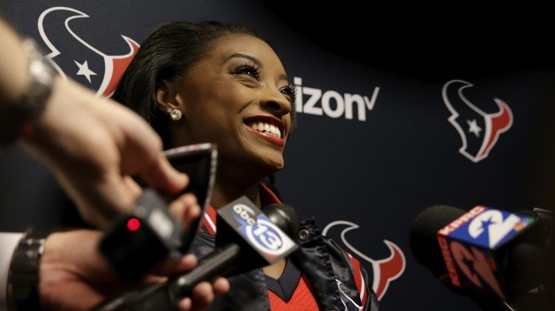 HOUSTON, TX - DECEMBER 10: Simone Biles speaks with the media as she serves as an Honorary Texans Cheerleader before the game between the Houston Texans and the San Francisco 49ers at NRG Stadium on December 10, 2017 in Houston, Texas.   Tim Warner/Getty Images/AFP