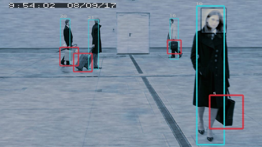 Pedestrians being viewed from a surveillance camera, marked with squares
