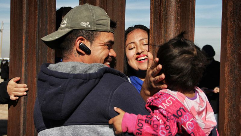"Members of a family reunite through the border wall between Mexico and United States, during the ""Keep our dream alive"" event, in Ciudad Juarez, Chihuahua state, Mexico on December 10, 2017.
