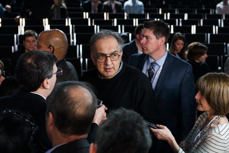Sergio Marchionne (C), Chief Executive Officer of Fiat Chrysler Automobiles (FCA), speaks to reporters after the unveiling of the 2019 Jeep Cherokee during a press preview at the 2018 North American International Auto Show (NAIAS) in Detroit, Michigan, on January 16, 2018. Car makers appealed to Americans' deep love of SUVs and trucks on at the Detroit Auto Show, unveiling a host of choices from luxurious to utilitarian, while also beefing up the humble sedan. / AFP PHOTO / Jewel SAMAD
