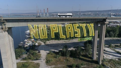 """Greenpeace activists wave a big 50 metters long and 15 metters tall transperant wich says: No Plastic"""" over 60 metters high Asparuhov bridge in the Black sea town of Varna, Thursday, Aug. 11, 2017. The environmental organizations Greenpeace started the campaign """"Break Free from Plastics"""" with the purpose of transforming it into a citizens' movement demanding less plastics in our lives and our seas and more sustainable solutions. Photo by: Petar Petrov/Impact Press Group/NurPhoto"""