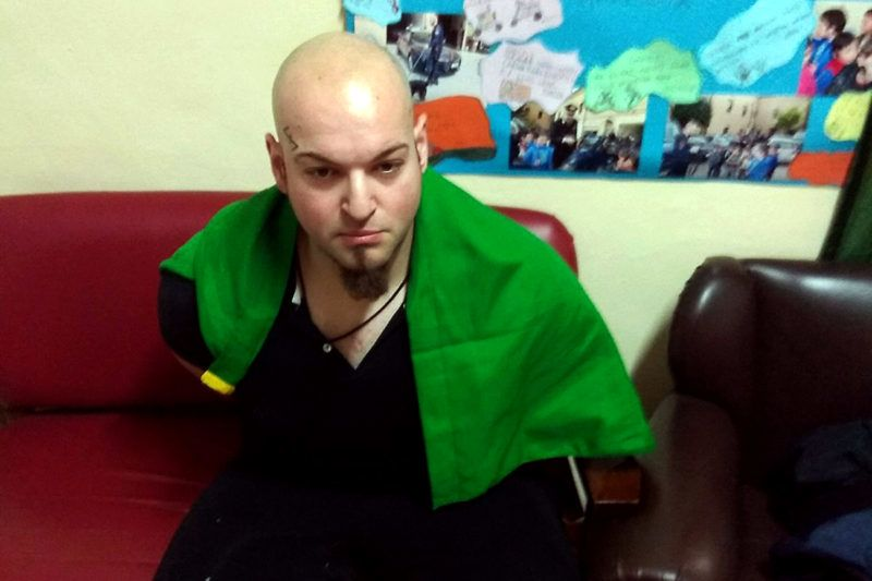"""This handout picture released by the Italian Carabinieri Press Office on February 3, 2018 shows Italian national Luca Traini arrested for suspected of wounding several foreign nationals in a drive-by shooting in Macerata. Italian police have arrested a far-right supporter suspected of wounding several foreigners in a drive-by shooting on February 3, in what local media called a racially motivated attack. After the assault in the central town of Macerata, the suspect got out of his car and made a fascist salute with a tricolour Italian flag draped over his shoulders, Italian media reported. / AFP PHOTO / ITALIAN CARABINIERI PRESS OFFICE / HO / RESTRICTED TO EDITORIAL USE - MANDATORY CREDIT """"AFP PHOTO /ITALIAN CARABINIERI PRESS OFFICE"""" - NO MARKETING NO ADVERTISING CAMPAIGNS - DISTRIBUTED AS A SERVICE TO CLIENTS"""