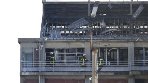 Firefighters work at the site of an explosion at the Saipol factory in Dieppe on February 17, 2018 which left one person dead and another missing. One technician died and another is missing after an explosion occurred in one of the large tanks of the Saipol oil production plant during a maintenance operation in Dieppe, according to French MP Sebastien Jumel. / AFP PHOTO / CHARLY TRIBALLEAU