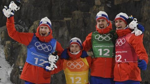 (from L) Gold medallists Norway's Robert Johansson, Johann Andre Forfang, Andreas Stjernen and Daniel Andre Tande celebrate during the victory ceremony following the men's large hill team ski jumping final round event during the Pyeongchang 2018 Winter Olympic Games on February 19, 2018, in Pyeongchang. / AFP PHOTO / Christof STACHE