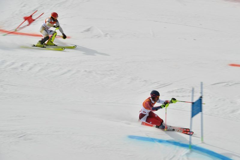 Switzerland's Ramon Zenhaeusern (R) and Hungary's Dalibor Samsal compete in the Alpine Skiing Team Event 1/8 finals at the Jeongseon Alpine Center during the Pyeongchang 2018 Winter Olympic Games in Pyeongchang on February 24, 2018. / AFP PHOTO / Fabrice COFFRINI