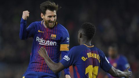 Barcelona's Argentinian forward Lionel Messi (L) celebrates with Barcelona's French forward Ousmane Dembele after scoring his second goal during the Spanish league football match between FC Barcelona and Girona FC at the Camp Nou stadium in Barcelona on February 24, 2018. / AFP PHOTO / LLUIS GENE