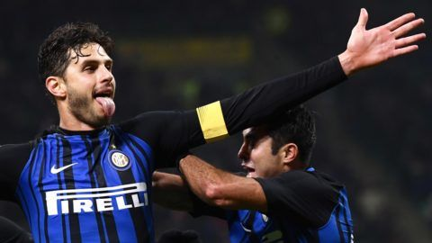 Inter Milan's defender Andrea Ranocchia from Italy (L) celebrates after scoring during the Italian Serie A football match Inter Milan Vs Benevento on February 24, 2018 at the San Siro stadium in Milan. / AFP PHOTO / MARCO BERTORELLO