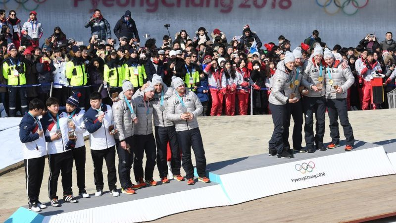 Silver medal winners South Korea's Won Yunjong's team (L), silver medal winners Germany's Nico Walther's team (C), and gold medal winner Germany's Francesco Friedrich's team pose on the podium in the 4-man bobsleigh during the Pyeongchang 2018 Winter Olympic Games, at the Olympic Sliding Centre on February 25, 2018 in Pyeongchang.  / AFP PHOTO / Mark RALSTON