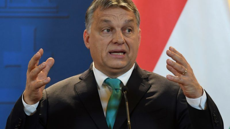 Prime Minister of Hungary Viktor Orban gestures as he gives a joint press conference with his Polish counterpart (not in picture) at the Hungarian parliament in Budapest on January 3, 2018. / AFP PHOTO / Attila KISBENEDEK