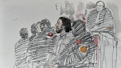 "A courtroom sketch made on February 5, 2018 shows prime suspect in the November 2015 Paris attacks Salah Abdeslam prior to the opening of his trial at the ""Palais de Justice"" courthouse in Brussels, on February 5, 2018. / AFP PHOTO / Benoit PEYRUCQ"