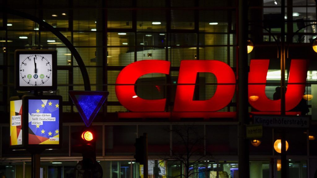 """A clock displays almost midnight in front of the Christian Democrats (CDU) headquarters on February 6, 2018 in Berlin as negotiators from German chancellor's CDU, her Bavarian CSU ally and the SPD gather for one last push to clinch an agreement on a renewed """"grand coalition"""". Coalition talks between Germany's centre-left and conservative parties dragged on into the morning of February 7, 2018 after Chancellor Angela Merkel negotiated through the night to break four months of paralysis in Berlin. / AFP PHOTO / Tobias SCHWARZ"""
