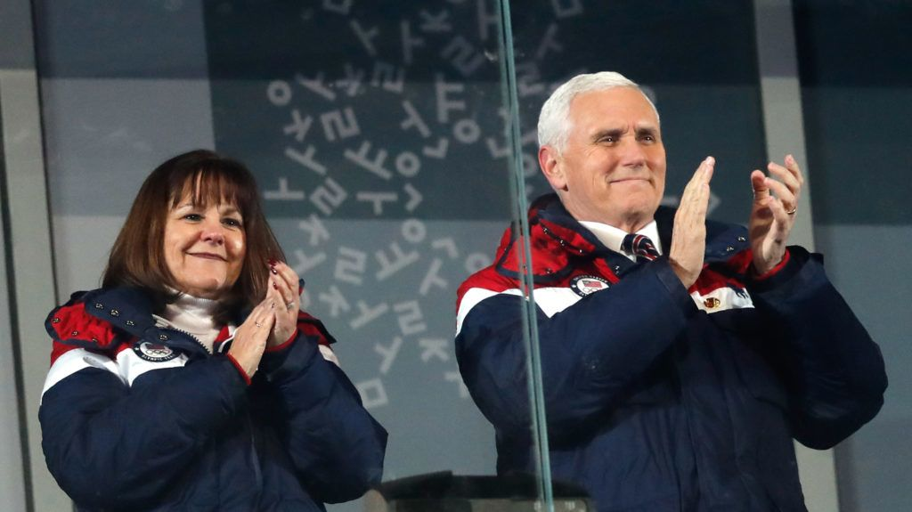 US Vice President Mike Pence (R) and his wife Karen attend the opening ceremony of the Pyeongchang 2018 Winter Olympic Games at the Pyeongchang Stadium on February 9, 2018.  / AFP PHOTO / Odd ANDERSEN