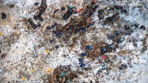 An aerial picture taken in the Ramensky district, on the outskirts of Moscow on February 12, 2018 shows emergency rescuers working at the site of the plane crash which occured the day before. Rescuers on February 12, 2018 searched through deep snow for body parts and debris after a Russian passenger plane crashed near Moscow minutes after take-off, killing all 71 people on board, in the country's deadliest air crash since 2016. The Antonov An-148 plane went down in a snow-covered field, making it difficult to access, with emergency workers forced to reach the wreckage by foot or on snowmobiles. / AFP PHOTO / Dmitry SEREBRYAKOV