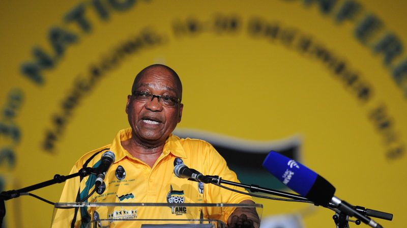 (FILES) In this file photo taken on December 16, 2012 South African President Jacob Zuma delivers a speech during the opening ceremony of the 53rd National Conference of the African National Congress (ANC), in Bloemfontein.  South Africa's calm and often jovial Jacob Zuma is a former herdboy who fought in the anti-apartheid struggle and has clung on to the presidency despite a string of scandals. Now aged 75, he has survived by building a network of loyal African National Congress (ANC) lawmakers and officials, and by trading on the party's legacy as the organisation that ended white-minority rule. / AFP PHOTO / STEPHANE DE SAKUTIN