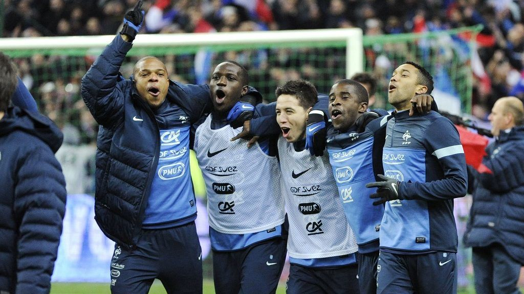 Loic Remy, Moussa Sissoko, Samir Nasri, Rio Mavuba and Gael Clichy of France celebrate at the end of the 2014 World Cup qualifying play-off second leg football match between France and Ukraine at the Stade de France in Saint-Denis, outside Paris, on November 19, 2013. Photo Jean Marie Hervio / Regamedia / DPPI