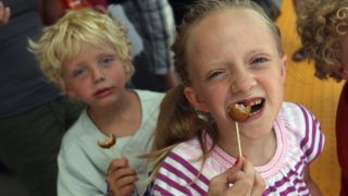 CENTENNIAL, CO - JULY 26:  Sofia Hickey, 8, eats free Swedish meatballs handed by Ikea to customers and their families awaiting the grand opening of the new Ikea home furnishings store on July 26, 2011 in Centennial, Colorado. Some shoppers camped for two days in be the first in line ahead of Wednesday's opening. The first 38 people were to receive free sofas. The 415,000 square-foot megastore is the Swedish company's first store and restaurant in Colorado, 38th in the U.S., and 324th worldwide.  (Photo by John Moore/Getty Images)