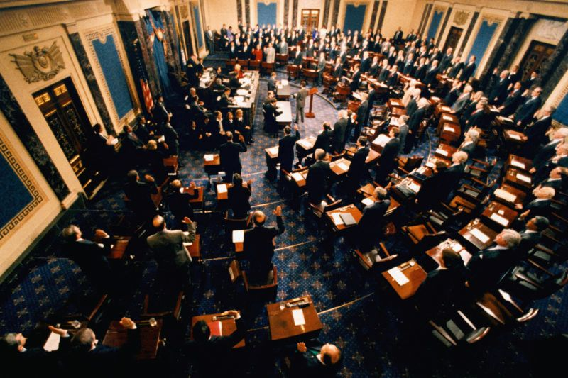 In the chamber of the United States Senate, Supreme Court Chief Justice William Rehnquist swears in the Senate members to participate in the impeachment trial of President William Jefferson Clinton. (Photo by © Wally McNamee/CORBIS/Corbis via Getty Images)