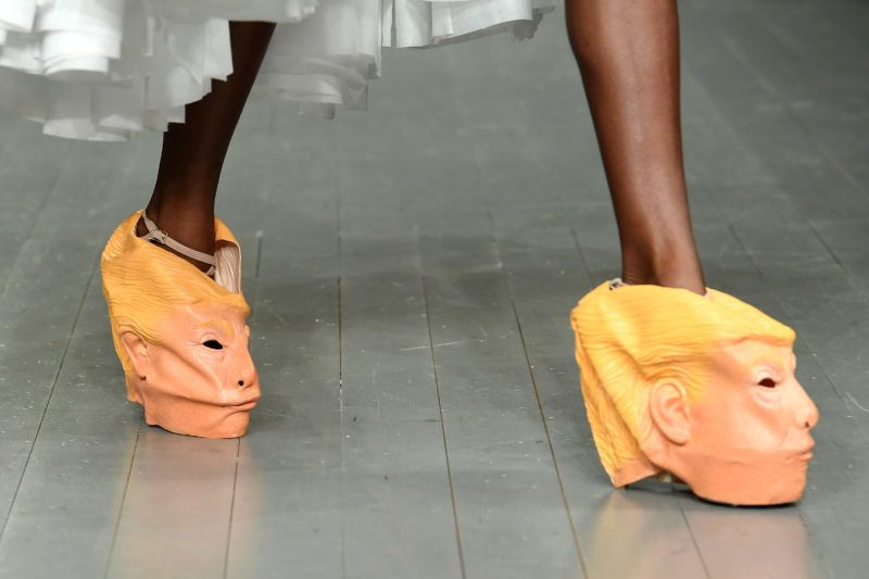 LONDON, ENGLAND - FEBRUARY 16:  A model, Donald Trump shoe detail, walks the runway at the Central Saint Martins MA show during London Fashion Week February 2018 at BFC Show Space on February 16, 2018 in London, England.  (Photo by Jeff Spicer/BFC/Getty Images)