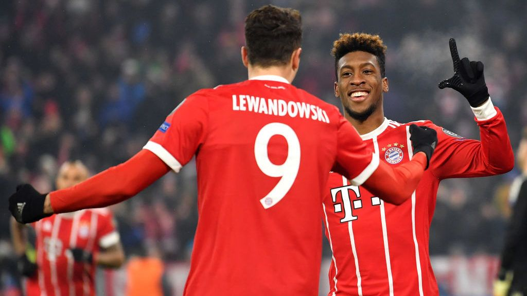 MUNICH, GERMANY - FEBRUARY 20:  Kingsley Coman of Bayern Muenchen celebrates with teammate Robert Lewandowski after scoring his sides second goal during the UEFA Champions League Round of 16 First Leg  match between Bayern Muenchen and Besiktas at Allianz Arena on February 20, 2018 in Munich, Germany.  (Photo by Sebastian Widmann/Bongarts/Getty Images)