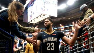 NEW ORLEANS, LA - FEBRUARY 23:  Anthony Davis #23 of the New Orleans Pelicans is congratulated by fans after his team defeated the Miami Heat in overtime at the Smoothie King Center on February 23, 2018 in New Orleans, Louisiana. NOTE TO USER: User expressly acknowledges and agrees that, by downloading and or using this photograph, User is consenting to the terms and conditions of the Getty Images License Agreement.  (Photo by Sean Gardner/Getty Images)