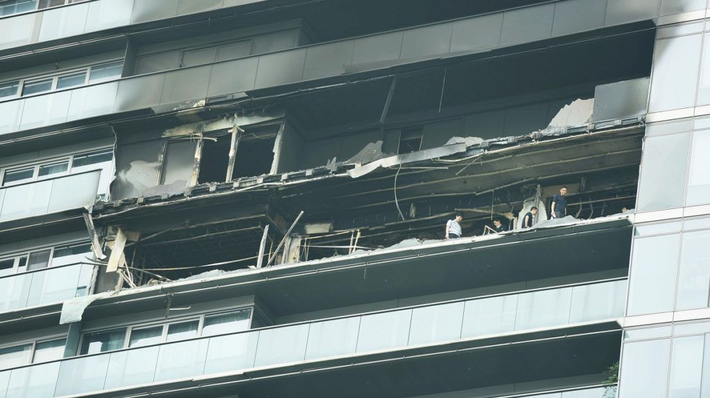 View of the fire incident site after a baby sitter intentionally set her master's house on fire, killing four people, at a high grade residence in Hangzhou city, east China's Zhejiang province, 22 June 2017.  A 34-year-old babysitter intentionally set her master's house on fire arround 5 am at a high grade residence in Hangzhou city, east China's Zhejiang province, 22 June 2017. The scene of fire was on the 18th floor of a high grade residence and the fire burned over 50 square meters. The hostess and her three children were all dead in the fire. The master's husband said his wife was in good relations with the babysitter and the babysitter once borrowed money from her. After being questioned by police, the babysitter admitted having stolen watches and children's bracelets from the house.