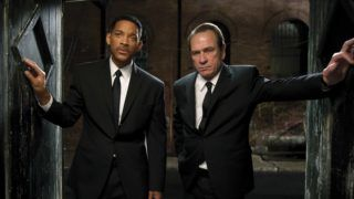 """In this film image released by Sony Pictures, Tommy Lee Jones, right, and Will Smith star are shown in a scene from """"Men in Black 3."""" (AP Photo/Columbia Pictures-Sony, Wilson Webb)"""