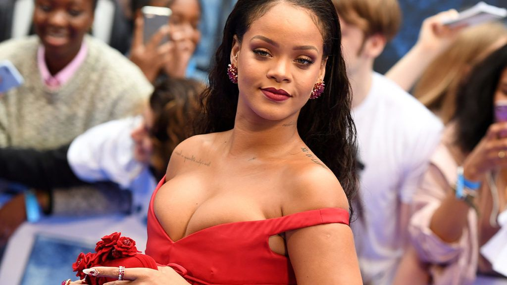 """Barbadian singer and actress Rihanna poses for a photograph upon arrival for the European premiere of """"Valerian and The City of a Thousand Planets"""" in London on July 24, 2017. / AFP PHOTO / Chris J Ratcliffe"""