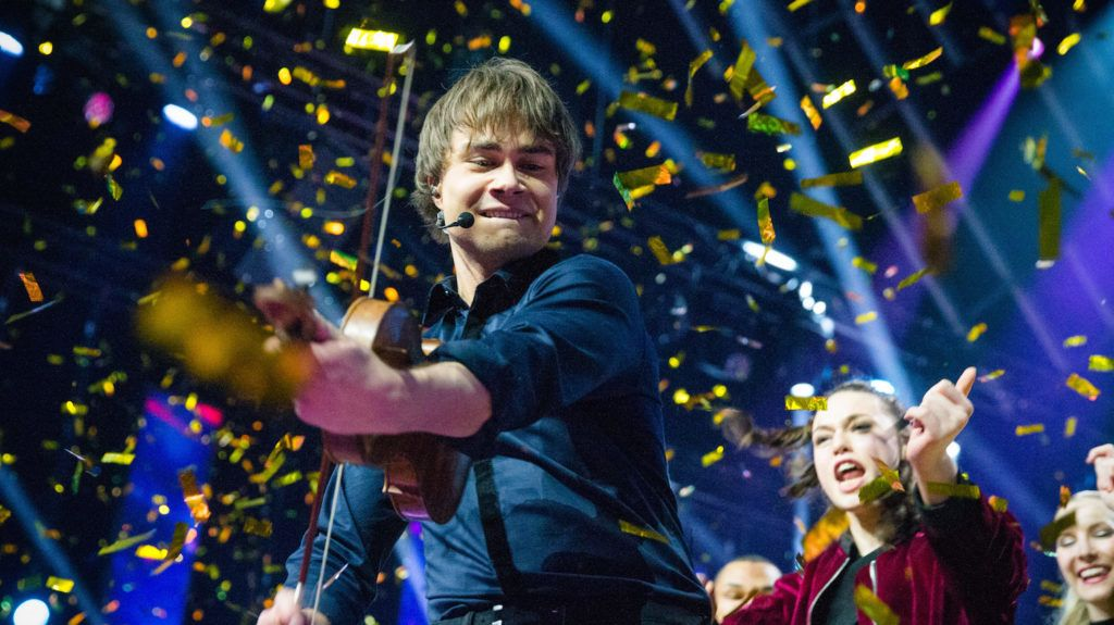 """Norwegian musician Alexander Rybak plays a violin in Oslo on March 10, 2018, during a national competition and his victory seals his representing Norway in the Eurovision Song Contest 2018 with his """"That's How You Write a Song"""".  / AFP PHOTO / NTB scanpix / Audun Braastad / Norway OUT"""