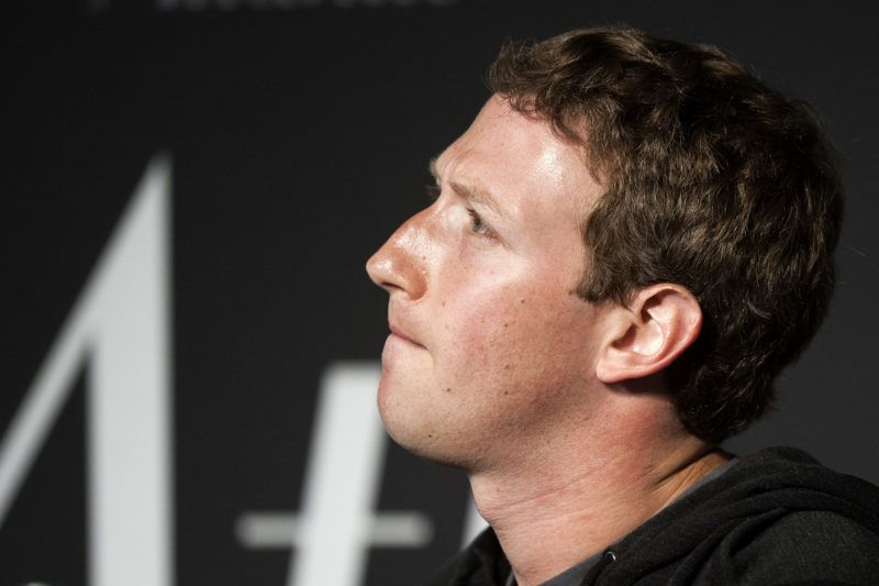 """(FILES) In this file photo taken on September 18, 2013 Facebook Founder and CEO Mark Zuckerberg speaks during an interview session with The Atlantic at the Newseum in Washington, DC.Zuckerberg, breaking his silence over the data scandal roiling the social network, acknowledged on March 21, 2018, the company made """"mistakes"""" and needs to """"step up"""" to fix the problem. """"We have a responsibility to protect your data, and if we can't then we don't deserve to serve you,"""" Zuckerberg said in his first public comments since the scandal broke. / AFP PHOTO / Jim WATSON"""