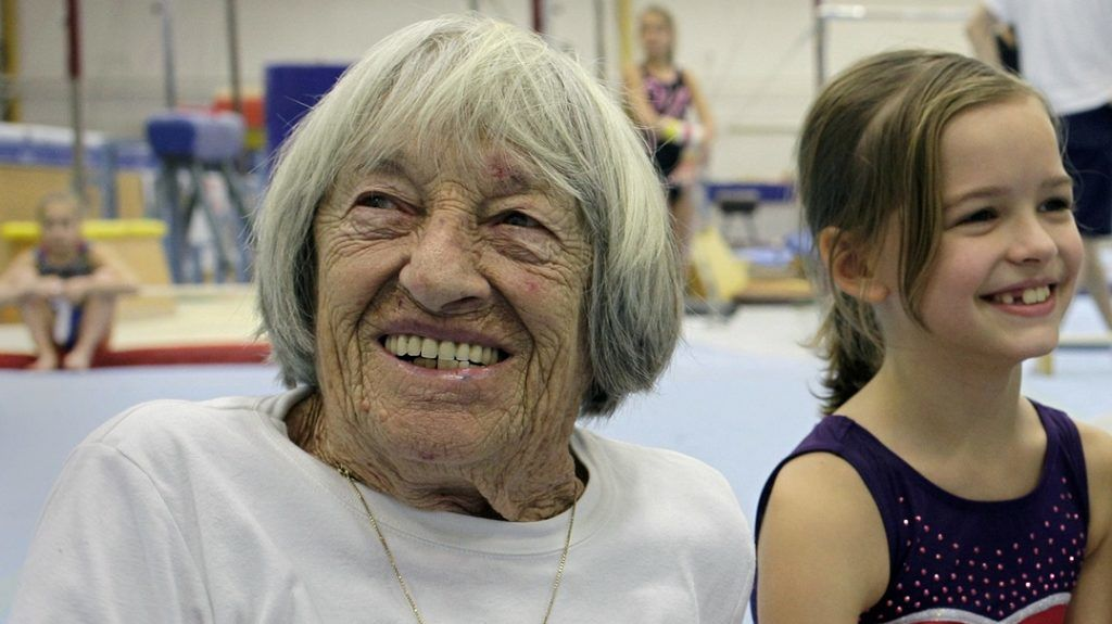 The oldest female olympic winner, Hungarian born Agnes Keleti, 95, poses with a Hungarian gymnast in a local training center of Budapest on January 16, 2016.    Keleti is a five-time gold medalist of the artistic gymnastic category at the Olympic Games in Helsinki (1952) and Melbourne (1956). Keleti, born in Hungary in 1921 but living in Israel since 1957, last month celebrated her 95th birthday in the Hungarian capital.   / AFP PHOTO / PETER KOHALMI