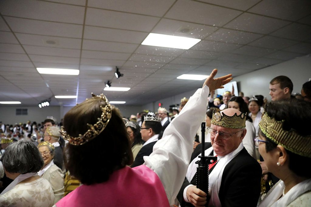 """NEWFOUNDLAND, PA - FEBRUARY 28: A church offical throws water during a ceremony at the World Peace and Unification Sanctuary in Newfoundland, Pennsylvania on February 28, 2018 in Newfoundland, Pennsylvania. The controversial church, which is led by the son of the late Rev. Sun Myung Moon, believes the AR-15 symbolizes the """"rod of iron"""" in the biblical book of Revelation, and it has encouraged couples to bring the weapons to a Ňcommitment ceremonyÓ or ŇPerfection Stage Book of Life Registration BlessingÓ. Officials in the rural area in the Pocono Mountains have reportedly told elementary school parents that their children will be relocated on Wednesday to accommodate the AR-15 ceremony. The semiautomatic rifles are similar to the weapons used in a Florida high school shooting two weeks earlier.   Spencer Platt/Getty Images/AFP"""