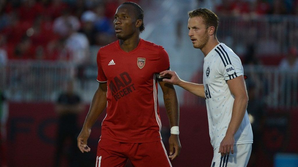PHOENIX, AZ - JUNE 10: Didier Drogba #11 of Phoenix Rising FC is guarded by Andy Thoma #44 of Vancouver Whitecaps II in the first half at Phoenix Rising Soccer Complex on June 10, 2017 in Phoenix, Arizona.   Jennifer Stewart/Getty Images/AFP