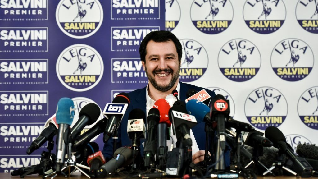 Lega far right party leader Matteo Salvini smiles at the Lega headquarter in Milan on March 5, 2018 during a press conference ahead of the Italy's general election results. A surge for populist and far-right parties in Italy's weekend election could result in a hung parliament with a right-wing alliance likely to win the most votes but no majority, AFP reports. / AFP PHOTO / Piero CRUCIATTI