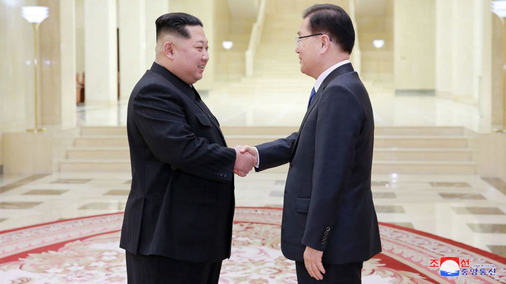 """This picture taken on March 5, 2018 and released from North Korea's official Korean Central News Agency (KCNA) on March 6, 2018 shows North Korean leader Kim Jong-Un (L) shaking hands with South Korean chief delegator Chung Eui-yong (R), who travelled as envoys of the South's President Moon Jae-in, during their meeting in Pyongyang. North Korean leader Kim Jong Un discussed ways to ease tensions on the peninsula with visiting South Korean envoys, the state KCNA news agency reported on March 6. / AFP PHOTO / KCNA VIA KNS / STR / / AFP PHOTO / KCNA VIA KNS / STR / SOUTH KOREA OUT / REPUBLIC OF KOREA OUT   ---EDITORS NOTE--- RESTRICTED TO EDITORIAL USE - MANDATORY CREDIT """"AFP PHOTO/KCNA VIA KNS"""" - NO MARKETING NO ADVERTISING CAMPAIGNS - DISTRIBUTED AS A SERVICE TO CLIENTS"""