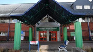 """A general view shows the main entrance to Salisbury District Hospital in Salisbury, southern England, on March 6, 2018 where a man and a woman remain in critical condition which sparked an ongoing major incident which started on March 4.  British police raced on March 6 to identify an unknown substance that left a former Russian double agent fighting for his life, in what a senior lawmaker said bore the hallmarks of a Russian attack. Moscow said it had no information about the """"tragic"""" collapse of the man, identified by the media as Sergei Skripal, in the quiet southern English city of Salisbury on Sunday, but said it would be happy to cooperate if requested by British authorities. Specialist officers from the counter-terrorism squad are helping investigate the incident, which also left a 33-year-old woman -- reported to be Skripal's daughter Yulia -- in a critical condition in what is feared to be a poison plot.  / AFP PHOTO / Chris J Ratcliffe"""