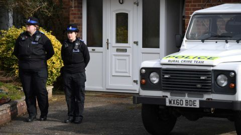 """British Police Community Support Officers stand on duty outside a residential property in Salisbury, southern England, on March 6, 2018, believed to have been cordonned off in connection with the major incident which started at The Maltings shopping centre in Salisbury on March 4. British police raced on March 6 to identify an unknown substance that left a former Russian double agent fighting for his life, in what a senior lawmaker said bore the hallmarks of a Russian attack. Moscow said it had no information about the """"tragic"""" collapse of the man, identified by the media as Sergei Skripal, in the quiet southern English city of Salisbury on Sunday, but said it would be happy to cooperate if requested by British authorities. Specialist officers from the counter-terrorism squad are helping investigate the incident, which also left a 33-year-old woman -- reported to be Skripal's daughter Yulia -- in a critical condition in what is feared to be a poison plot. / AFP PHOTO / Chris J Ratcliffe"""