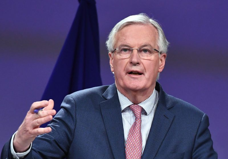 EU chief negotiator Michel Barnier addresses a press conference after his meeting with British Brexit minister at the European Commission in Brussels on March 19, 2018.  Britain and the European Union on March 19 reached a landmark deal on transition arrangements that will last for nearly two years after the Brexit divorce next year, EU negotiator Michel Barnier said.  / AFP PHOTO / EMMANUEL DUNAND